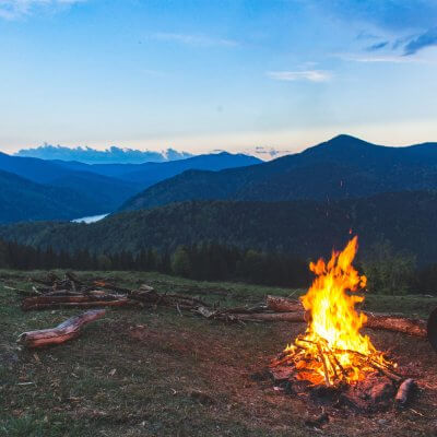 bonfire-surrounded-with-green-grass-field-1061640