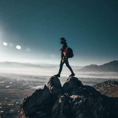 person-standing-on-top-of-rock-1576937